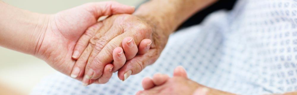 Nurse-Holding-Patient-Hand